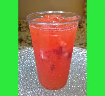 Fresh squeezed strawberry and lemonade over ice